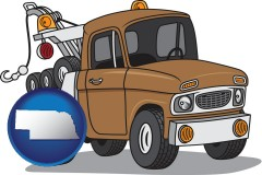 nebraska map icon and an automobile tow truck