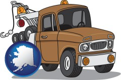 alaska map icon and an automobile tow truck