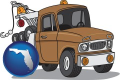 florida map icon and an automobile tow truck