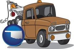 oklahoma map icon and an automobile tow truck