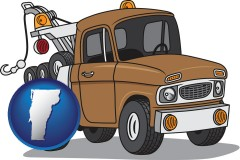 vermont map icon and an automobile tow truck